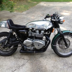 A Hinkley Triumph Thruxton with a Sprint style tank + Cafe style seat - the perfect combo!