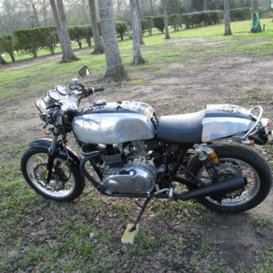 Triumph Thrux with part painted chequered flag design