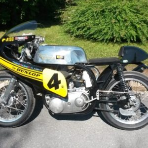 Tank and seat unit on a Royal Enfield 500 racer,owned and raced by Ian Henshaw of Performance Classics.