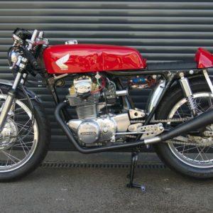 A painted Ducati tank on a Honda CB350
